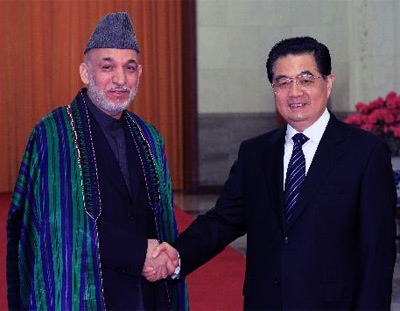 Hamid Karzai and Hu Jinta